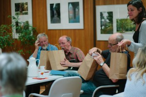 Participants examine the bags